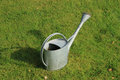 Watering can watering pot on the grass Stock Images
