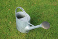 Watering can watering pot on the grass Stock Photo