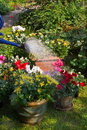 Watering flowerpots with new plants Royalty Free Stock Photo