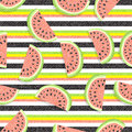 Watermelon background. Pattern of juicy slices of watermelon and horizontal stripes. With texture of denim fabric