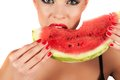 Watermelon beautiful young woman eat juicy over white Royalty Free Stock Images