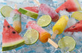 Watermelon, fruit popsicle and lime slices