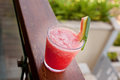 Watermelon juice in glass horizontal sits on a railing a resort Stock Photo