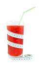Watermelon juice and meter on white background Royalty Free Stock Images