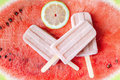 Watermelon and lime popsicles on fresh and natural background. Royalty Free Stock Photo