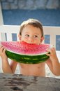 Watermelon little boy eating big slice of Royalty Free Stock Images