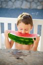 Watermelon little boy eating big slice of Stock Image