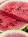 Watermelon pieces cut and lying together several of on one another red ripe Royalty Free Stock Images