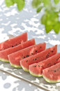 Watermelon shot in the shade of a tree table of fresh Royalty Free Stock Image
