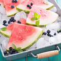 Watermelon slices on ice Royalty Free Stock Photo