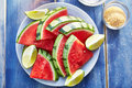 Watermelon slices on plate close up shot overhead with sugar and salt sprinkled top Stock Images