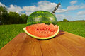 Watermelon slices on a wooden table background blue sky Royalty Free Stock Photography