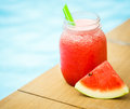Watermelon smoothies on the background of the pool. Royalty Free Stock Photo