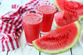Watermelon smoothies on white wooden background Royalty Free Stock Photo