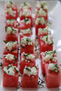 Watermelon squares with goat cheese Royalty Free Stock Photo