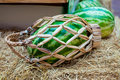 Watermelon wicker basket with a handle on the hay. Royalty Free Stock Photo