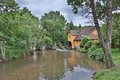 Watermill this photo shows a by a river in france Stock Photo