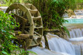 Watermill at the waterfall in laos Royalty Free Stock Photo