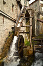 Watermill a wooden canal brings the water down to the wheel of a in bienno bergamo italy this is still active all the Stock Photography