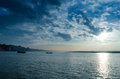 Waterscape landscape boats sailing in river dramatic sky with cloudy and sunbeams at allahabad indian asia Royalty Free Stock Photo