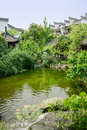 Waterside chinese traditional houses in verdant sunny summer woods on day chengdu china Stock Images