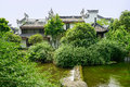 Waterside chinese traditional houses in woods on sunny summer da dwelling buildings day chengdu china Royalty Free Stock Image