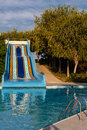 Waterslide in the swimming pool Stock Photo