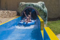 Waterslide in a tube picture the grandkids running rubber boat on water slide the is shot at the aqua park to hotel hilton sharm Royalty Free Stock Image