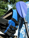 Watersport blues blue water sport equipment wait for a kayak trip Stock Photos