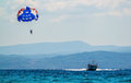 Watersport speed boat towing a parasail Royalty Free Stock Photography