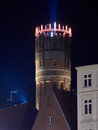 The watertower in Lueneburg, Germany, is illuminated by electri Royalty Free Stock Photo