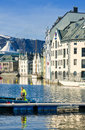 Waterway of alesund norway a man works in his boat along the known as alesundet in the coastal city in southwest on the norwegian Stock Images