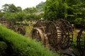 Waterwheel front of entrance to huanglong cave in china wooden yellow dragon is a karst located near the wulingyuan district Stock Image