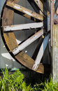 Waterwheel partial side view of a with water dropping out Royalty Free Stock Image