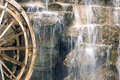 Waterwheel and waterfall the wooden is beside the Royalty Free Stock Photos