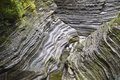 Rock formations allow a small creek to flow at Watkins Glen, NY State Park