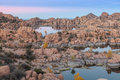 Watson lake fall sunset scenic near prescott arizona with interesting granite rock formations at in Royalty Free Stock Photography