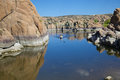 Watson lake kayaker kayaking on scenic near prescott arizona with interesting granite rock formations Royalty Free Stock Photos