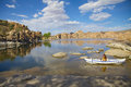 Watson lake and kayaker kayaking on scenic near prescott arizona with interesting granite rock formations Royalty Free Stock Photo