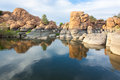 Watson lake prescott arizona granite rocks reflected on near Stock Image
