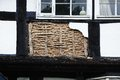 Wattle and daub architecture pembridge small panel of being restored on a traditional white timbered building herefordshire Stock Images