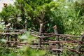 Wood Wattle fence in the garden Royalty Free Stock Photo