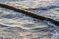 Wave breakers at the ocean of baltic sea Stock Photo