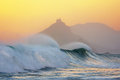 Wave breaking in Bakio near gaztelugatxe at sunset Royalty Free Stock Photo