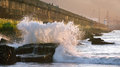 Wave breaking on getxo dock Stock Photos