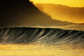 Wave breaking at sunset in Azkorri Royalty Free Stock Photo