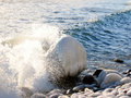 Wave breaking on Wintry coast Royalty Free Stock Photo