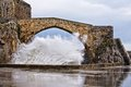 Wave at castro urdiales old bridge Royalty Free Stock Images
