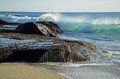 Wave crashing on rocks at Aliso Beach in Laguna Baech, California. Royalty Free Stock Photo