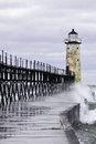 Wave soaked pier manitsee michigan with wind blown waves Stock Images